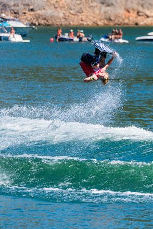 dowdy: FERREIRA DO ZEZERE, PORTUGAL - SEPTEMBER 19, 2015: Mike Dowdy USA during the WWA Supra World Wakeboard Championship 2015 in Ferreira do Zezere, Portugal. Editorial