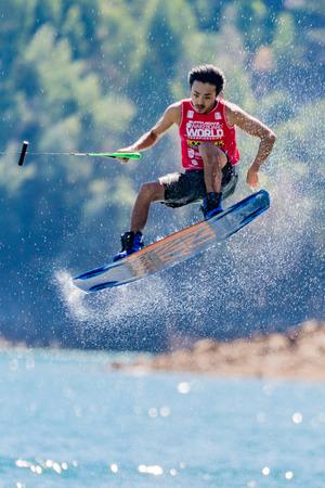 shota: FERREIRA DO ZEZERE, PORTUGAL - SEPTEMBER 19, 2015: Shota Tezuka (JPN) during the WWA Supra World Wakeboard Championship 2015 in Ferreira do Zezere, Portugal.