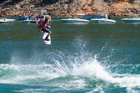 dowdy: FERREIRA DO ZEZERE, PORTUGAL - SEPTEMBER 19, 2015: Mike Dowdy (USA) during the WWA Supra World Wakeboard Championship 2015 in Ferreira do Zezere, Portugal. Editorial