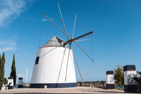 algarve: Old windmill in Castro Marim, Algarve, Porugal Stock Photo