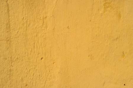 brushstroke: Yellow painted wall with brushstroke textured
