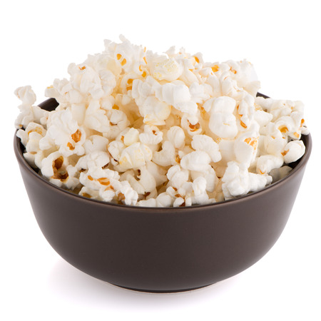 eating popcorn: Popcorn in a brown bowl on a white background
