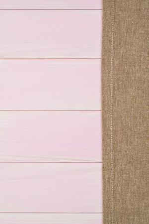 menu background: Beige towel over wooden kitchen table. View from above.