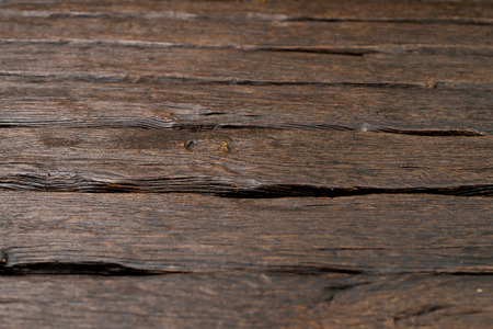 laths: Rustic old dark wooden board background.