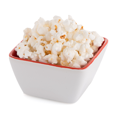 popcorn bowls: Popcorn in a white bowl on a white background Stock Photo