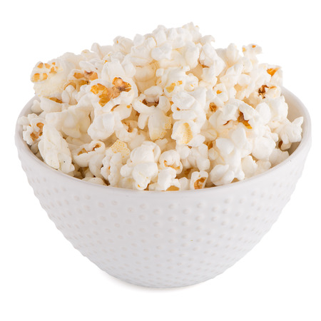 eating popcorn: Popcorn in a white bowl on a white background Stock Photo