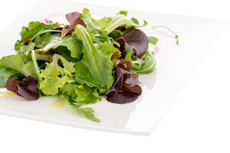 radicchio: Salad mix with rucola, frisee, radicchio and lambs lettuce. Isolated on white background.