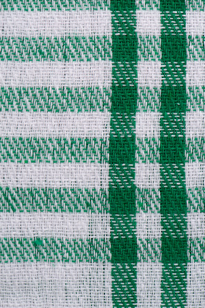 checked fabric: Closeup of green checked fabric background.
