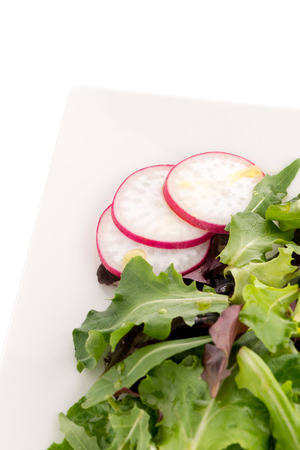 Salad mix with rucola, frisee, radicchio and lambs lettuce. Isolated on white background.