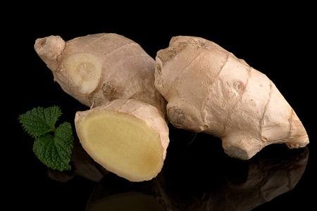 reflective background: Ginger root on black reflective background.