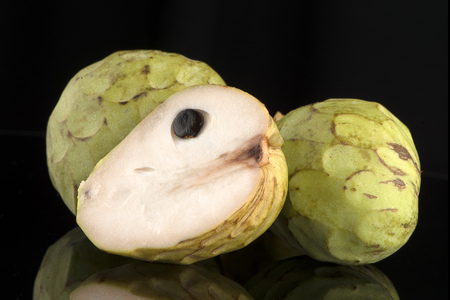 anona: Fresh Custard Apple isolated on black background