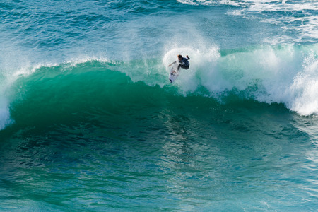 soli: ERICEIRA, PORTUGAL - JANUARY 12, 2015: Soli Bailey AUS during the 2016 World Junior Championships, Mens Junior Tour 1 at Ribeira DIlhas beach - Ericeira, Portugal.