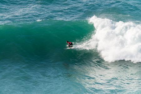 surf: ERICEIRA, PORTUGAL - JANUARY 12, 2015: Hiroto Ohhara JPN during the 2016 World Junior Championships, Mens Junior Tour 1 at Ribeira DIlhas beach - Ericeira, Portugal.