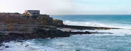 surfers: Portuguese Atlantic coast. Beach and rocks of Ericeira - good place for surfers