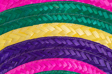 Abstract colorful background of woven straw.