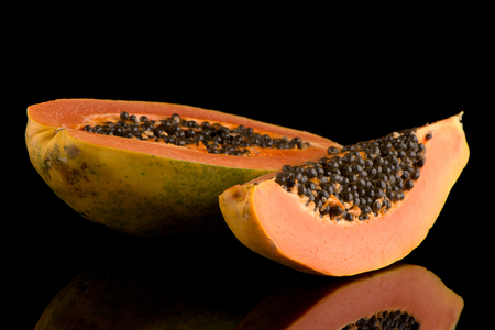 cutaneous: Fresh and tasty papaya on black background. Stock Photo