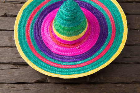 yellow tassel: Mexican sombrero on old dark wood background.