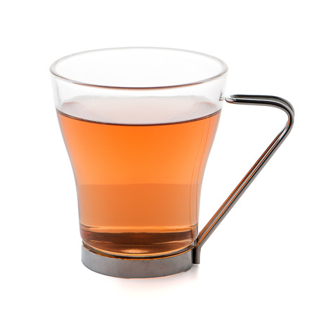 Glass cup of black tea isolated on white background.