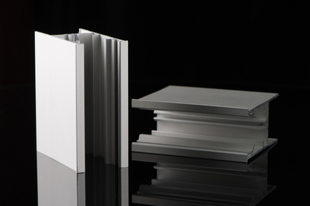 aluminium: Aluminium profile sample isolated on black background. Stock Photo