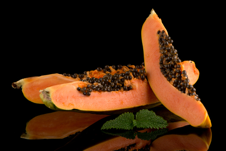 cutaneous: Fresh and tasty papaya on black background. Stock Photo