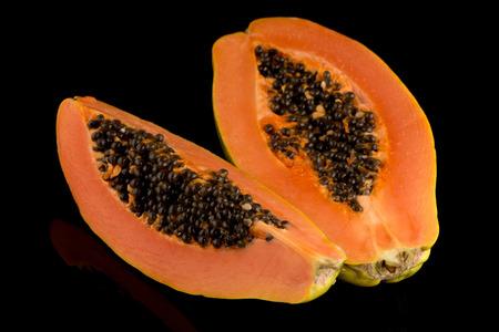 cranny: Fresh and tasty papaya on black background. Stock Photo