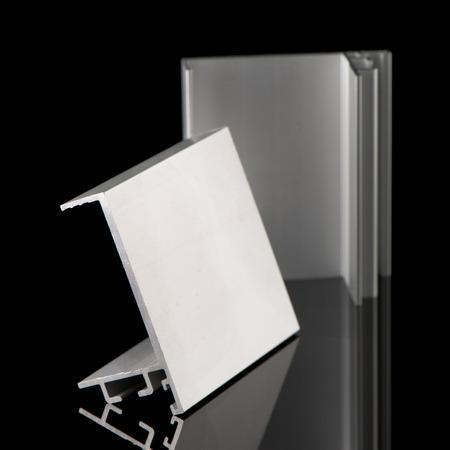 aluminium background: Aluminium profile sample isolated on black background. Stock Photo