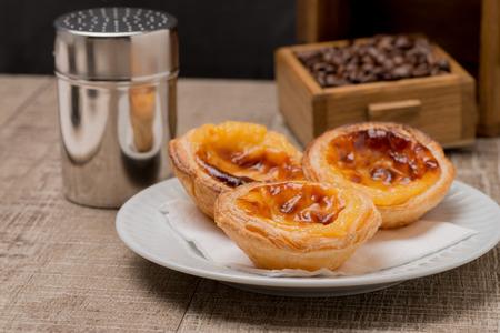 nata: Pasteis de Nata or Portuguese Custard Tarts on wooden table. Stock Photo