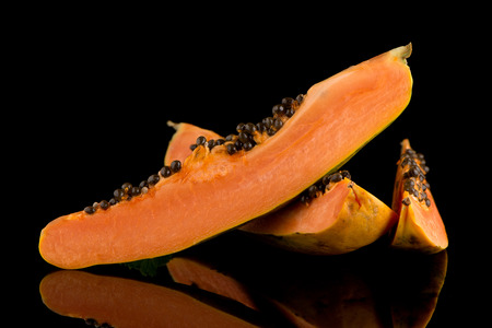 grope: Fresh and tasty papaya on black background. Stock Photo