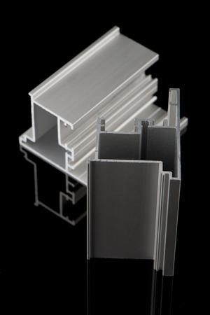 extrusion: Aluminium profile sample isolated on black background. Stock Photo