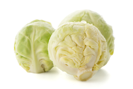 Fresh brussels sprouts isolated on white background. Stock Photo