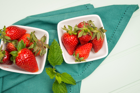 appetizing: Appetizing strawberry in the bowl on a wooden background.