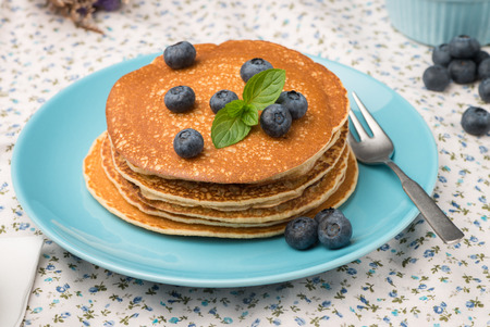 Delicious golden pancakes with fresh blackberries.