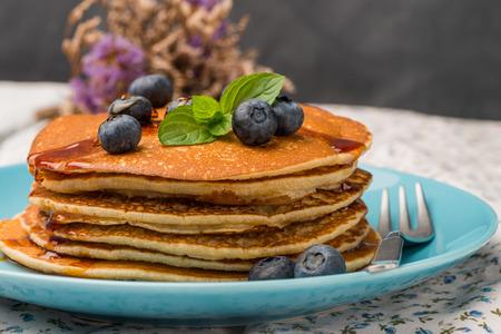 Delicious golden pancakes with fresh blackberries.