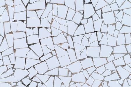 unrepeatable: White broken tiles wall texture.