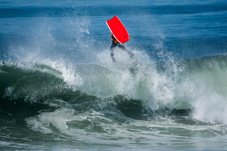 bodyboarding: Bodyboarder in action on the ocean waves on a sunny day. Stock Photo