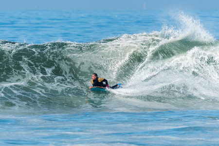 bodyboard: Bodyboarder in action on the ocean waves on a sunny day. Stock Photo