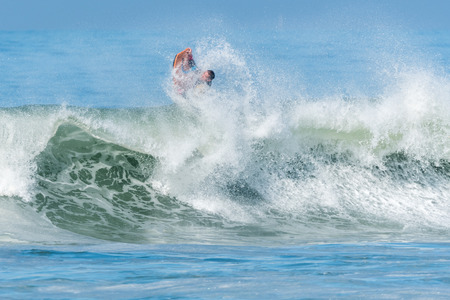bodyboarder: Bodyboarder in action on the ocean waves on a sunny day. Stock Photo