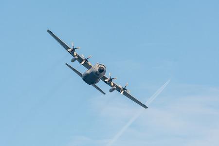 C-130 Hercules cargo plane in flight.