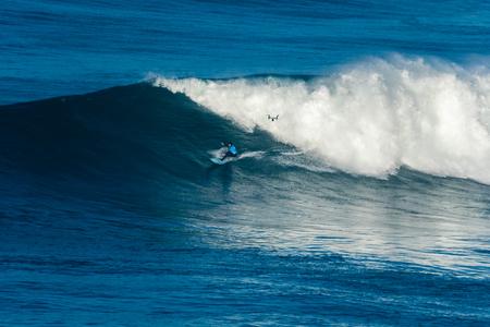 NAZARE, PORTUGAL - DECEMBER 20, 2016: Grant Baker (ZAF) during the Nazare Challenge 2016 - Big Wave Tour #3 at Praia do Norte - Nazare, Portugal. Editorial
