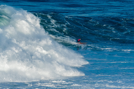 NAZARE, PORTUGAL - DECEMBER 20, 2016: Nic Lamb (USA) during the Nazare Challenge 2016 - Big Wave Tour #3 at Praia do Norte - Nazare, Portugal.