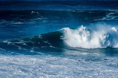 NAZARE, PORTUGAL - DECEMBER 20, 2016: Carlos Burle (BRA) during the Nazare Challenge 2016 - Big Wave Tour #3 at Praia do Norte - Nazare, Portugal.