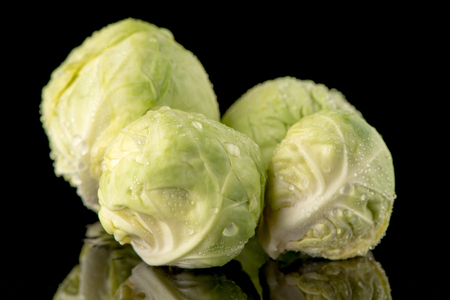 Fresh brussels sprouts isolated on black background.