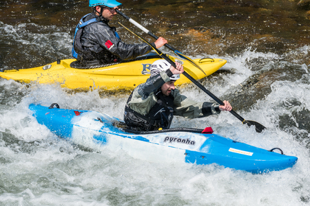 AROUCA, PORTUGAL - APRIL 23: Joao Tiago Silva on the blue kayak and unidentified athlete at the Paivafest on april 23, 2017 in Arouca, Portugal.