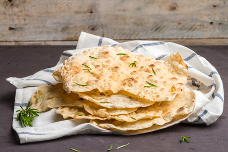 Homemade hot chapati on kitchen countertop background.