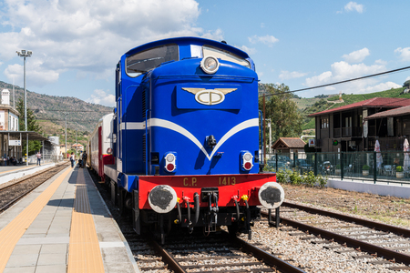traction engine: TUA, PORTUGAL - JULY 08, 2017: Historic train on Tuas Train Station. The train runs between June and October along the bank of the river Douro.
