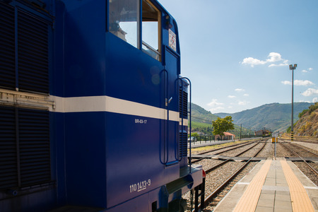 traction: TUA, PORTUGAL - JULY 08, 2017: Historic train on Tuas Train Station. The train runs between June and October along the bank of the river Douro.