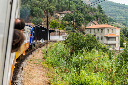 traction engine: Historic train arriving to Mirao Train Station. The train runs between June and October along the bank of the river Douro.