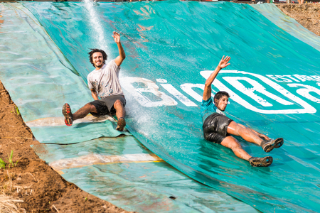 ESTARREJA, PORTUGAL - SEPTEMBER 23: Athletes sliding to mud and water at the Biorace on september 23, 2017 in Estarreja, Portugal.