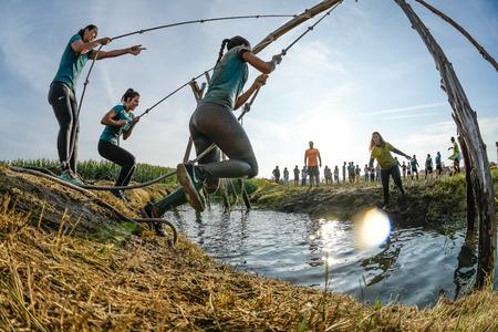 ESTARREJA, PORTUGAL - SEPTEMBER 23: Athletes go through mud and water at the Biorace on september 23, 2017 in Estarreja, Portugal.