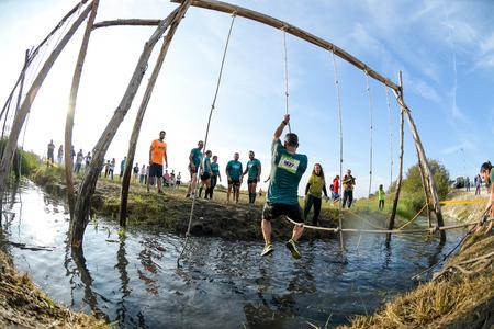 ESTARREJA, PORTUGAL - SEPTEMBER 23: Athletes go through mud and water at the Biorace on september 23, 2017 in Estarreja, Portugal. Editorial